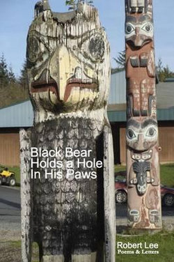 Black Bear Holds a Hole in His Paws